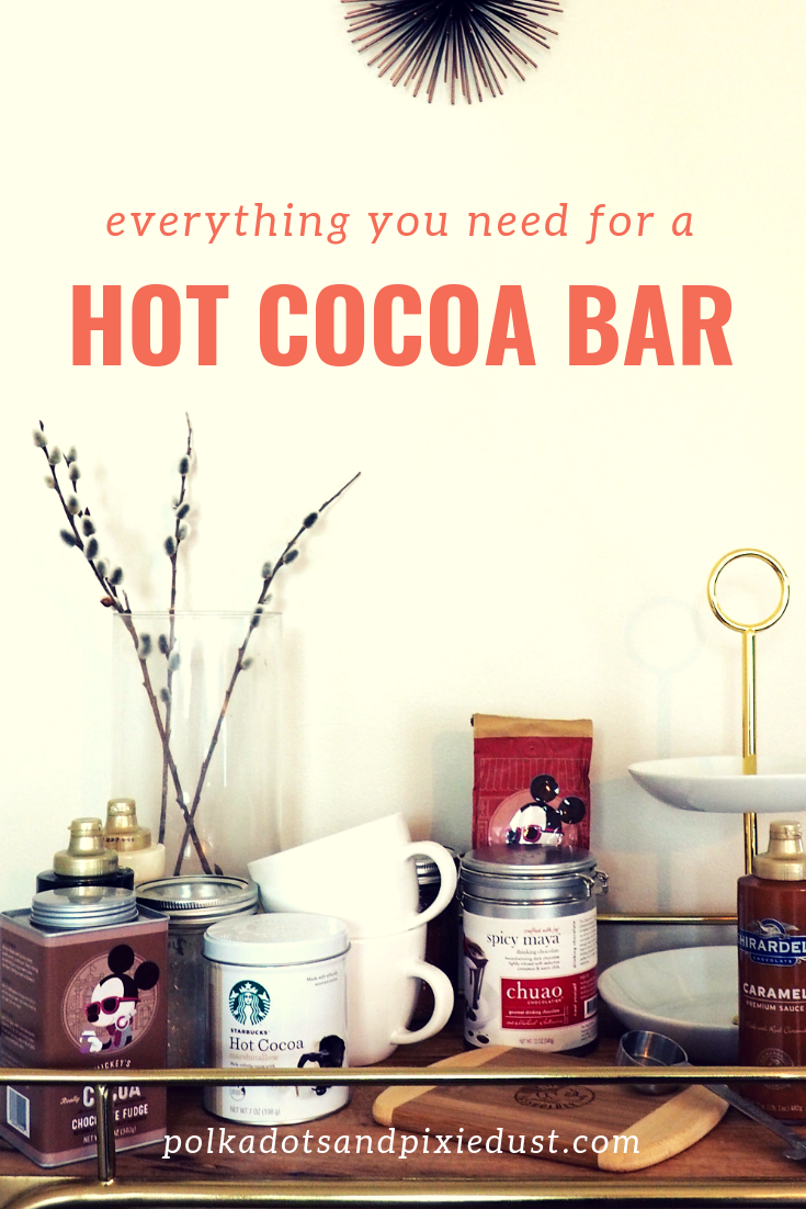 A hot cocoa party is easy to setup with this list of hot cocoa bar essentials. All our favorite hot cocoas, fixings, and tips for a hot cocoa bar to get you through fall and winter! #hotcocoabar #hotcocoaparty #hotchocolatebar #winterparty #polkadotpixies