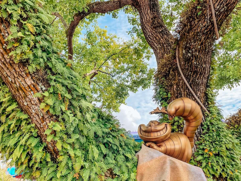 50th anniversary statues at magic kingdom cheshire cat