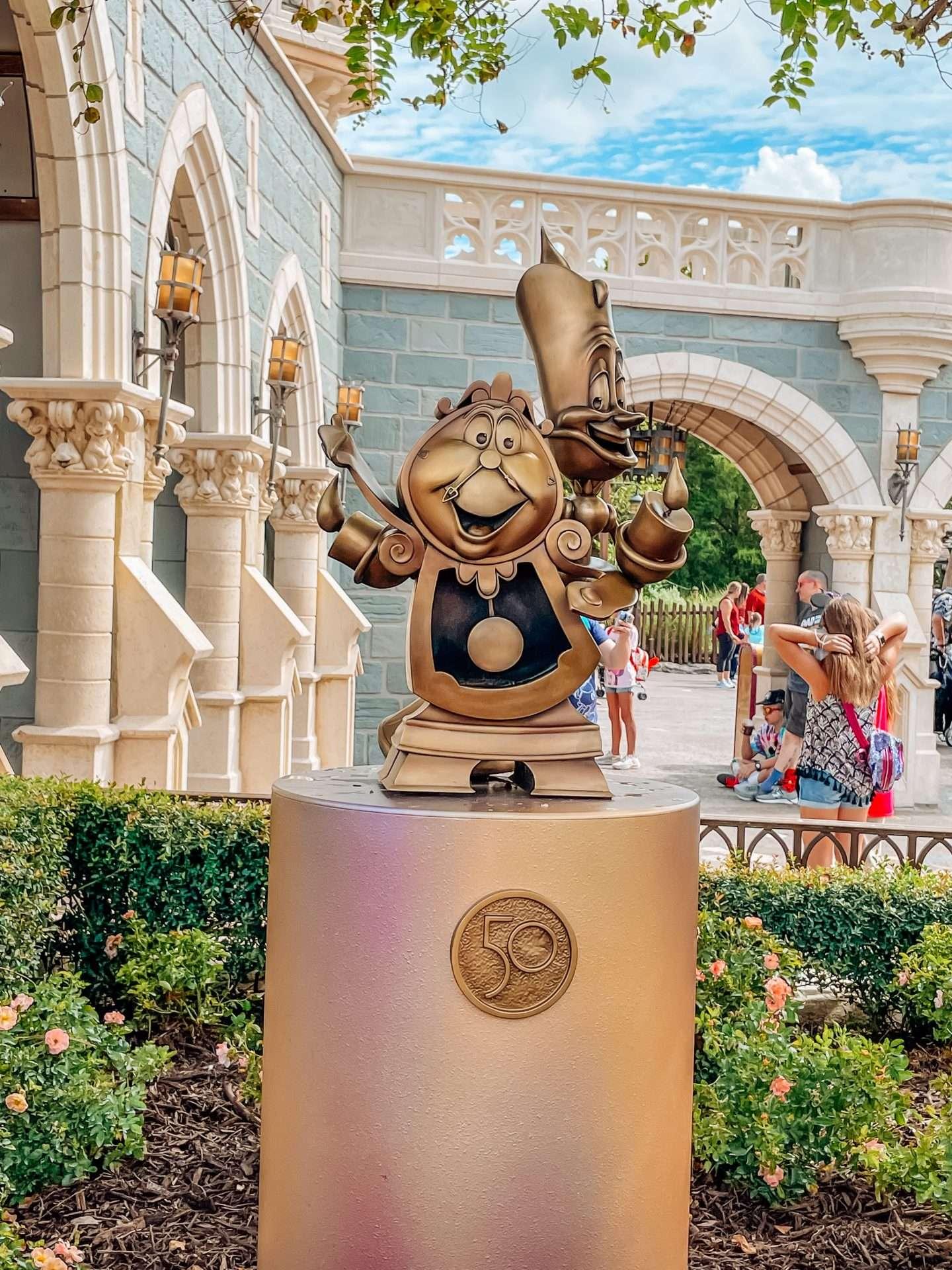 50th anniversary statues at magic kingdom