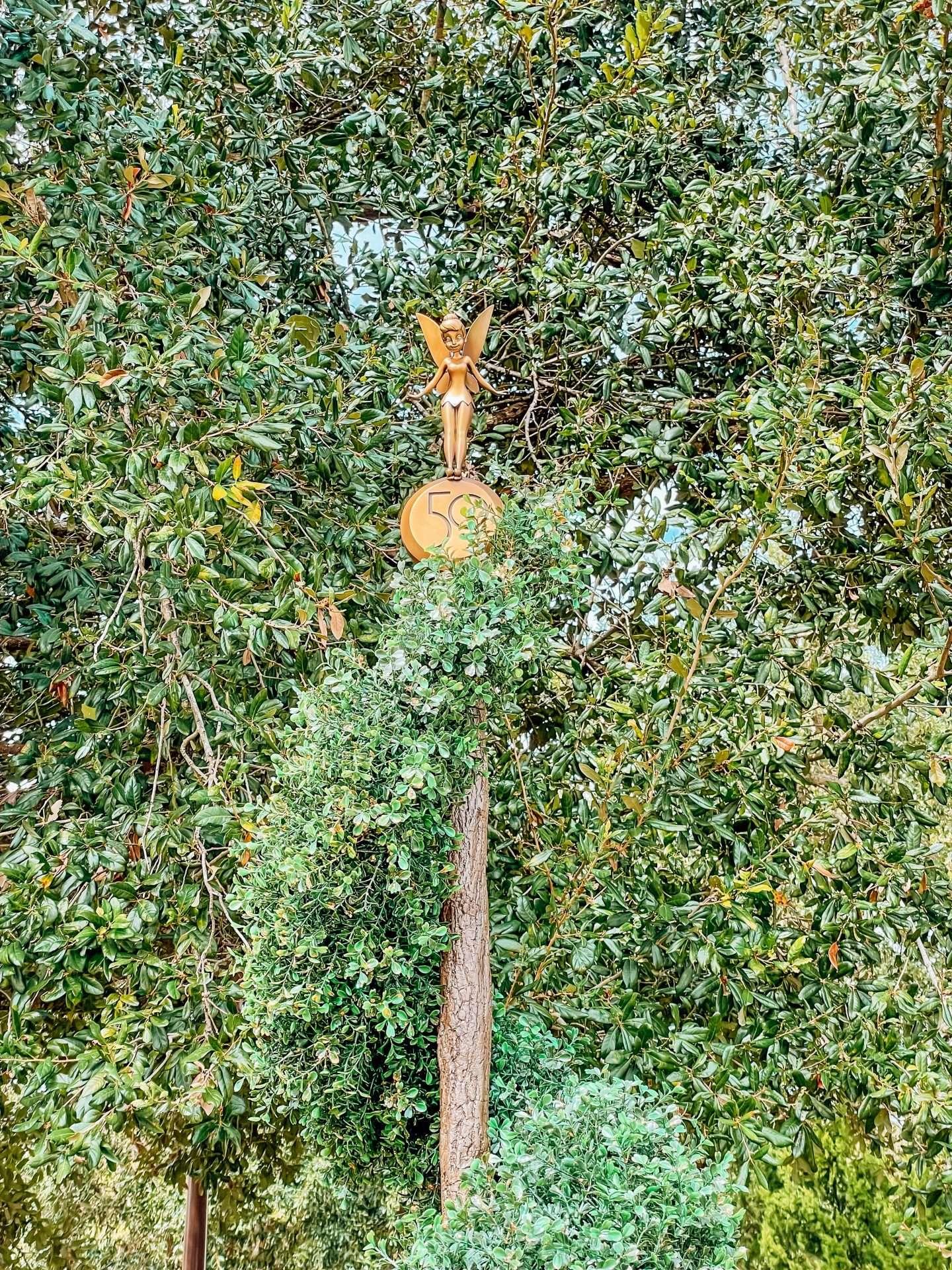 50th anniversary statues at magic kingdom tinkerbell